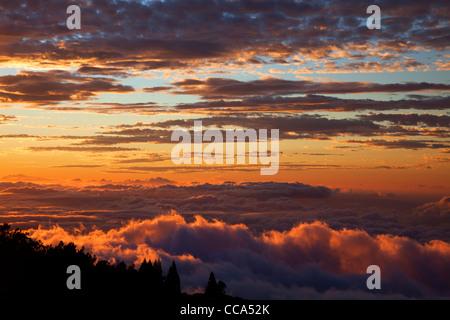 Sunset from near the top of Haleakala, Haleakala National Park, Maui, Hawaii. - Stock Photo