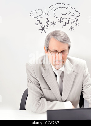 Closeup of a mature angry business man having a stress. Headache. Against white background - Stock Photo