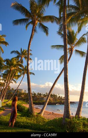 A visitor at Ulua Beach, Wailea, Maui, Hawaii. (model released) - Stock Photo