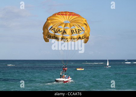 Boat, water and people parasailing mid-distance - Stock Photo