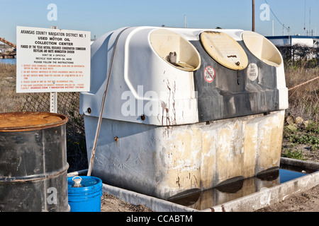 Man recycling used motor oil at auto parts store usa for Motor oil recycling center