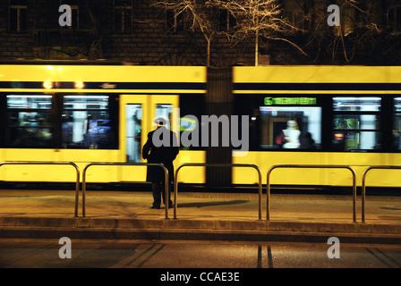 Man standing alone on platform, Budapest, Hungary, Europe - Stock Photo