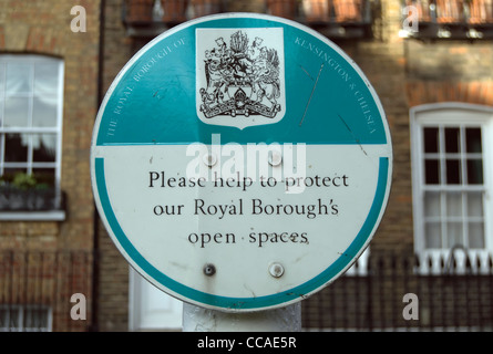 please help protect our royal boroughs open spaces signpost in chelsea, london, england - Stock Photo