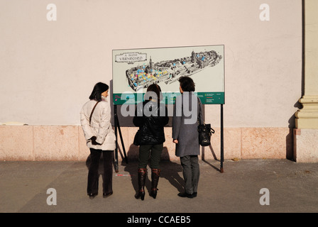 Tourists looking at map of Buda Castle District on the Castle Hill, Budapest, Hungary - Stock Photo