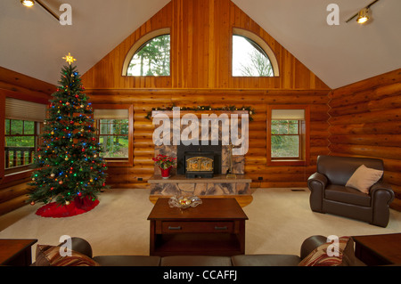 log cabin living room.  Log cabin living room wide angle view from behind couch Stock Photo showing other rooms of the
