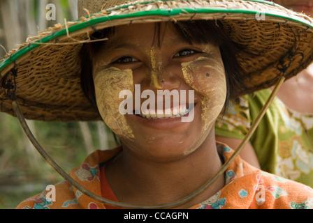 Teen girl wearing makeup Thanakha. A natural product, naturally produced. Myanmar Myanma Burma - Stock Photo