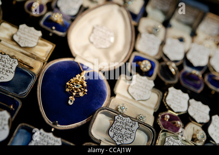 Beautiful secondhand jewellery in a shop window in Brighton Lanes, East Sussex England UK - Stock Photo