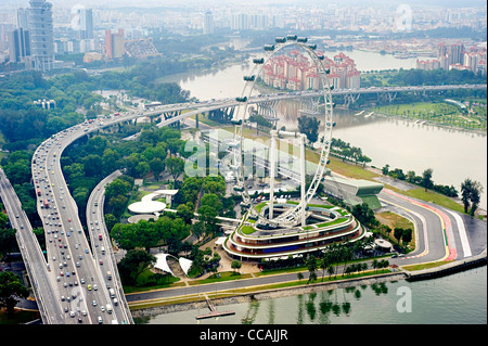 Aerial view on Singapore Flyer from Marina Bay Sands resort - Stock Photo