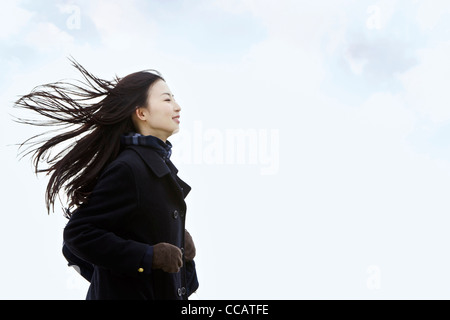 High school girl in the wind - Stock Photo