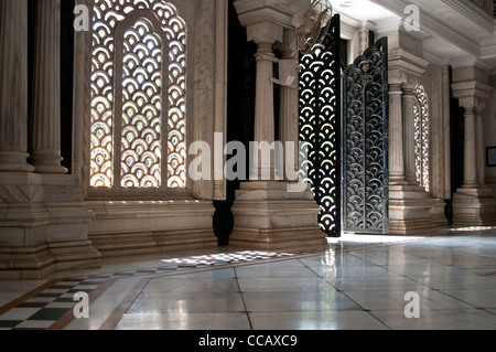 Latticed Windows and doors in the marble mausoleum, ISKCON, Krishna Balaram Mandir, Vrindavan, India - Stock Photo