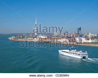 Ferry boating past cityscape of Portsmouth with modern spire in background - Stock Photo