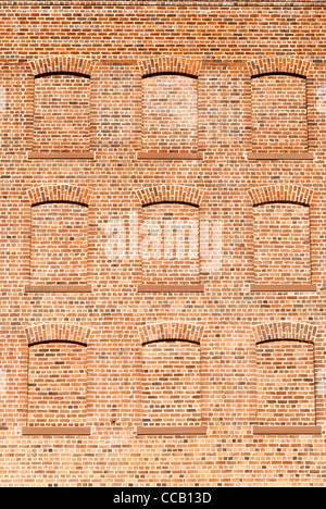 Decorative traditional red brick wall with bricked up windows Stock ...