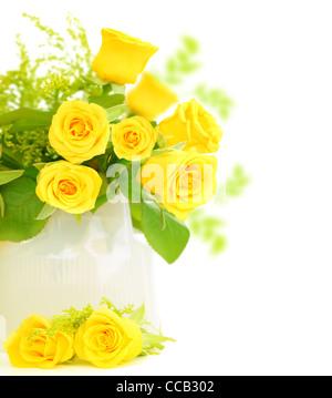 Fresh yellow roses border isolated on white background - Stock Photo
