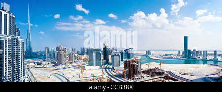 Panoramic image of Dubai city, modern cityscape, downtown with blue sky, luxury new high-tech city at Middle East - Stock Photo