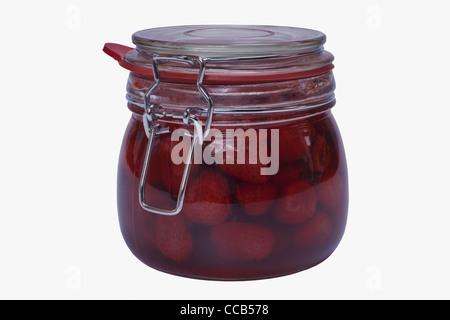 Ein Glas mit eingeweckten Erdbeeren | a jar with home canned strawberries - Stock Photo