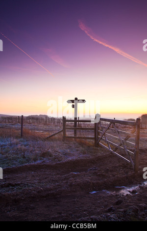 A frosty winter sunrise over the Ridgeway long distance path at Hackpen Hill, Wiltshire, England, UK - Stock Photo