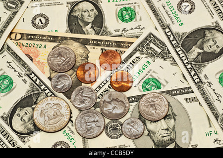 Detail photo of various U.S. American dollar bills, some coins are alongside - Stock Photo