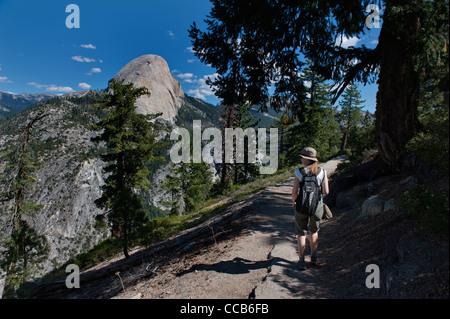 Hiking The Panoramic Trail. Liberty Cap. Yosemite National Park. California. USA - Stock Photo