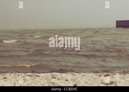 BROTHER AND SISTER IN THE WATER - Stock Photo