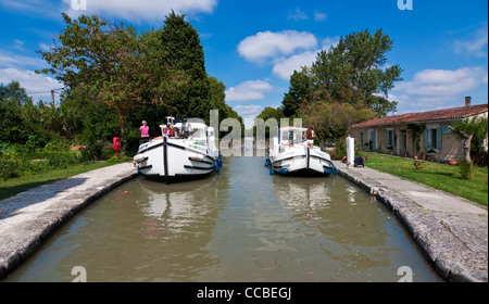 Two boats in a lock on the Canal du Midi - Southern France - Stock Photo