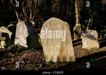 Gravestones, Highgate Cemetery, London, England, UK - Stock Photo