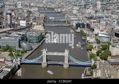 Aerial view of London looking west along the Thames from Tower Bridge - Stock Photo