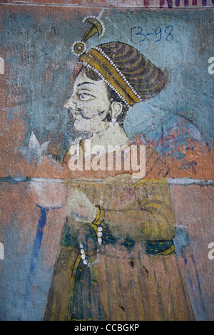 Painted and decorated Indian male figure on a wall in Jodhpur, in Rajasthan, India - Stock Photo
