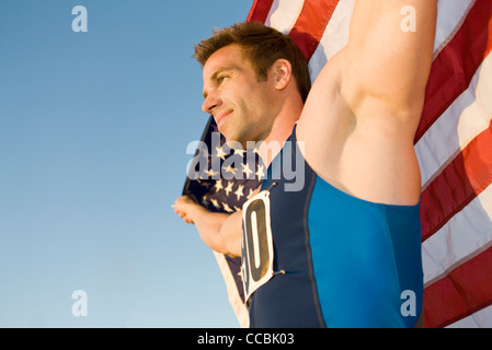 Athlete holding American flag, low angle view - Stock Photo