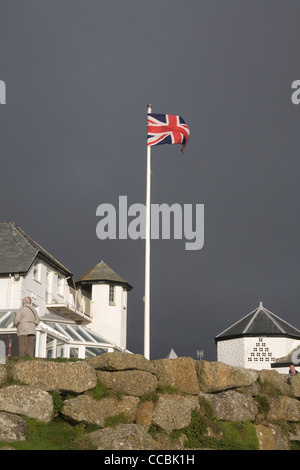 storm and union jack at lands end Cornwall - Stock Photo
