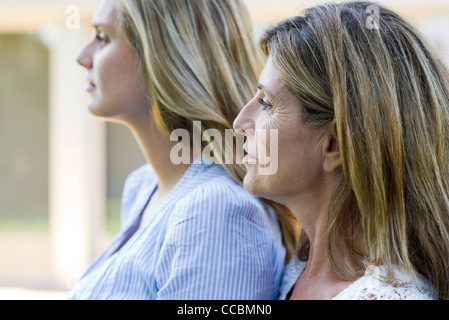Mother and grown-up daughter, side view - Stock Photo