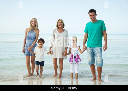 Multi-generation family at the beach, portrait - Stock Photo
