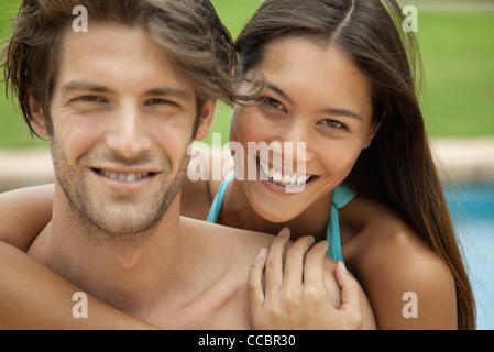 Couple embracing outdoors, portrait - Stock Photo
