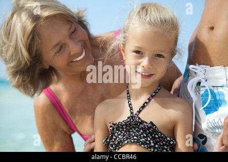 Grandmother and granddaughter at the beach - Stock Photo