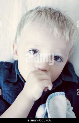 Little boy sucking his thumb, portrait Stock Photo
