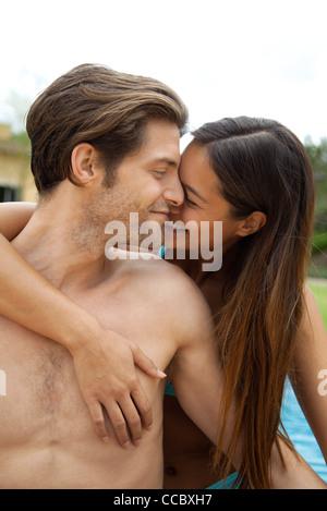 Couple embracing outdoors - Stock Photo