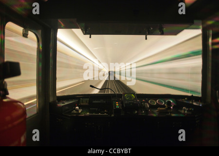 Train moving through tunnel, viewed through window - Stock Photo
