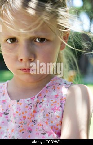 Little girl pulling face - Stock Photo