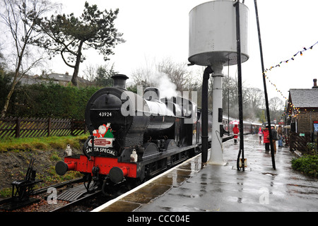 Santa Special at Oxenhope in Pouring Rain-2 - Stock Photo