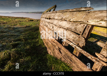 Rotten wreckage of a wooden boat on the banks of the River Severn - Stock Photo