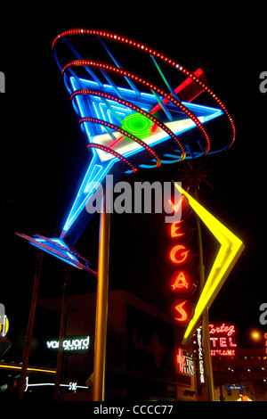 A giant martini glass in blue neon on Fremont Street in Las Vegas, NV, is part of the neon sign 'Fremont Street - Stock Photo