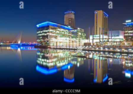 Media City Footbridge and Studios at MediaCityUK at Night, Salford Quays, Greater Manchester, England, UK - Stock Photo