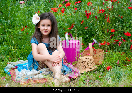 Sweet girl on the field with red poppies - Stock Photo