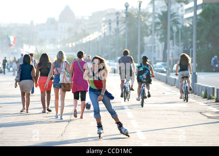 Pedestrians, cyclists and roller-bladers on the promenade in Nice on the Mediterranean coast in southern France. - Stock Photo
