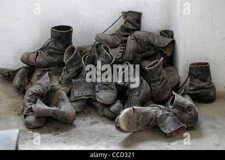 Pile of old shoes displayed  at prisoner's quarters in the Museum of Underground Prisoners which tells the story - Stock Photo
