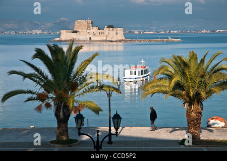 The harbour at Nafplio with the Bourtzi island and fort in the background, Argolid, Peloponnese, Greece. - Stock Photo