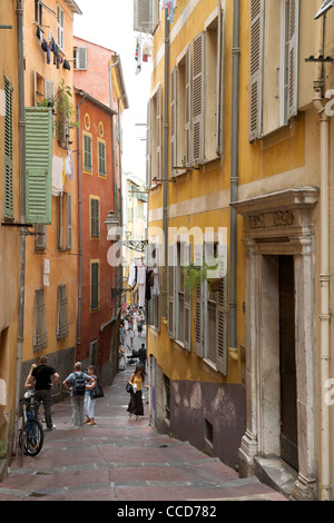 View down the narrow alleyways of the old town in Nice on the Mediterranean coast in southern France. - Stock Photo