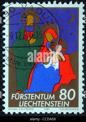 A greeting Christmas stamp printed in Liechtenstein shows Holy Family, circa 1981 - Stock Photo