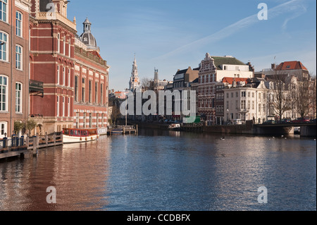 Amsterdam, Netherlands. The Amstel river. The tower of the Zuiderkerk is in the distance - Stock Photo