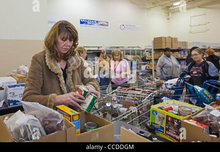 Volunteers Work at Food Pantry - Stock Photo