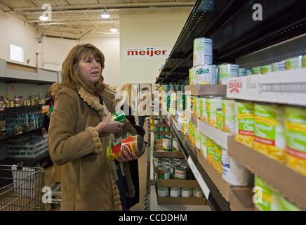 Volunteers Work at Food Pantry - Stock Photo